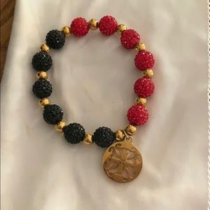 Rustic cuff. Red and black with gold